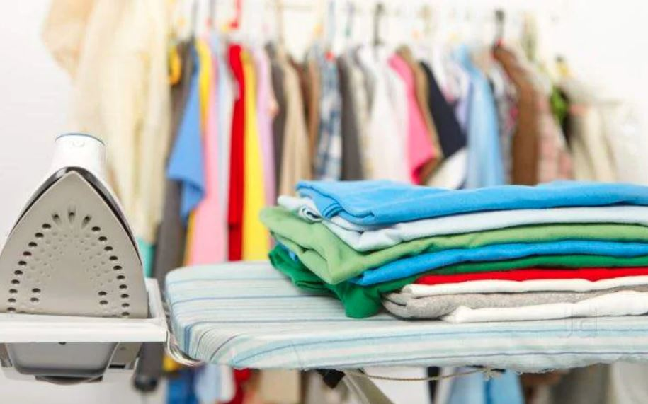 How do professional cleaners press clothes?